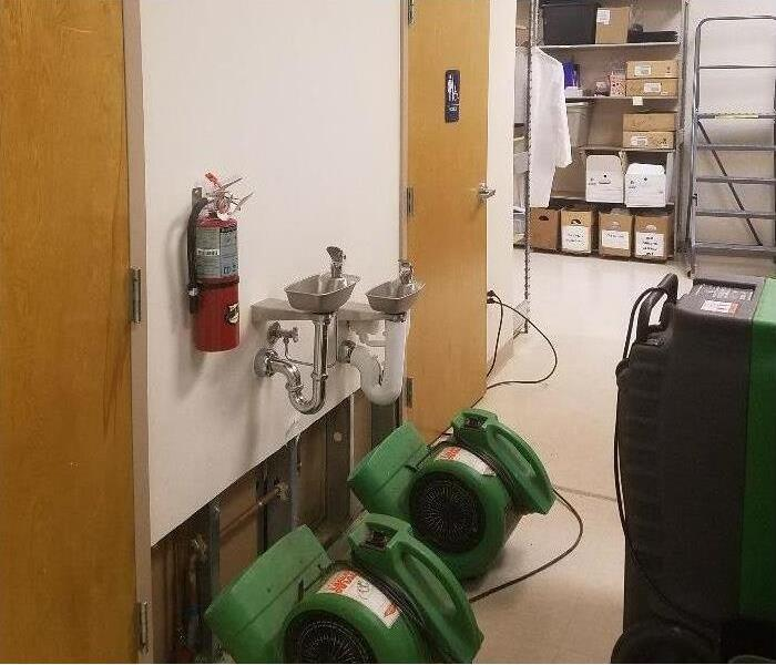 equipment set up to help repair water damage in local facility