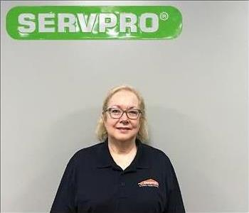 Jeanette Groves, female, under SERVPRO sign for employee picture